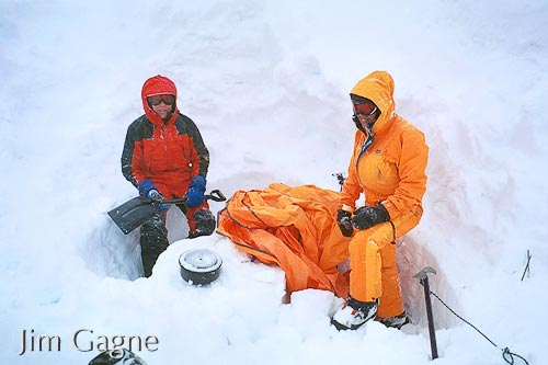 Dan Barter and Michelle Piro shoveling out after a storm at camp 2